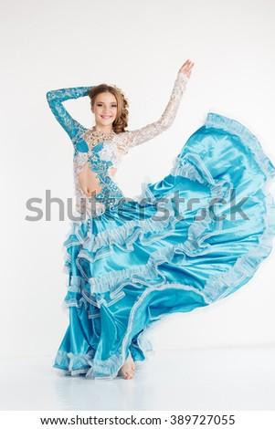 Dancing teen girl in fashion oriental dress - stock photo