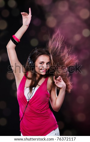Dancing teen in the headphones