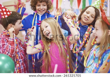 Dancing with friends at the birthday party - stock photo