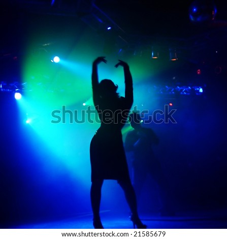 dancing woman in a disco, focus at the womin in the front