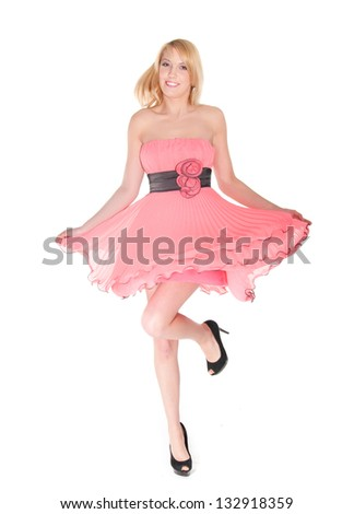 dancing  woman in pink dress over white background.