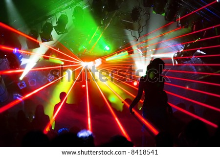 dancing woman on a podest in a disco - stock photo