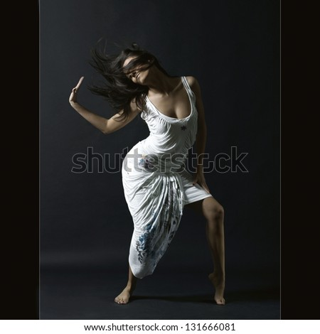 Dancing woman portrait - stock photo