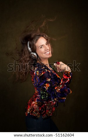 Dancing woman with long brunette hair and headphones