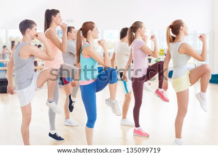 Dancing young people in fitness club