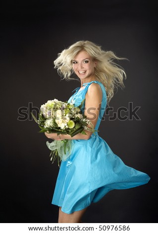 Dancing young pretty girl with the bunch of roses - stock photo