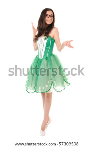 Dancing young woman in green ballet dress isolated on white background - stock photo