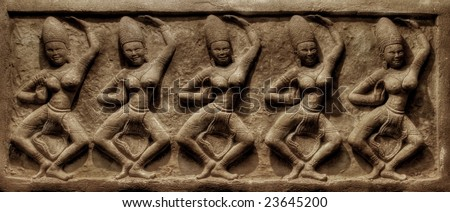 Dancings. Traditional Thai a bas-relief of wall. It is photographed on kho Chang island. Thailand - stock photo
