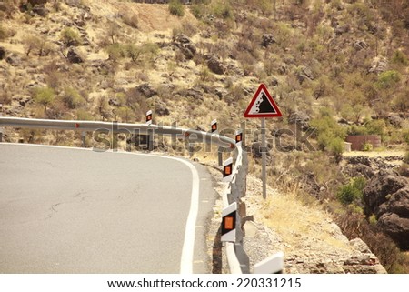 Danger cliff edge and falling rock signs - stock photo