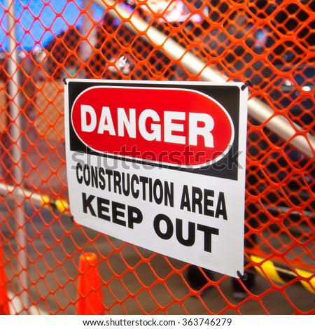 Danger Construction Area safety warning sign. Selective focus. - stock photo