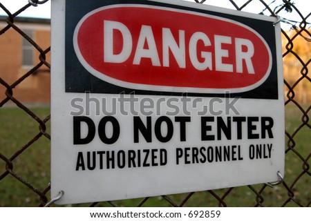 Danger do not enter sign on fence - stock photo