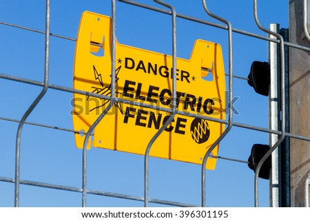 danger, electric fence - stock photo