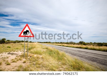 Danger Elephant Crossing Road Sign close to Country Road, Namibia, South West Africa - stock photo