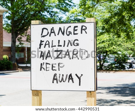 Danger Falling Hazard sign hand painted - stock photo