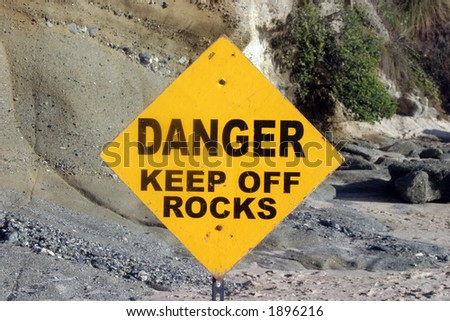 danger keep off rocks sign
