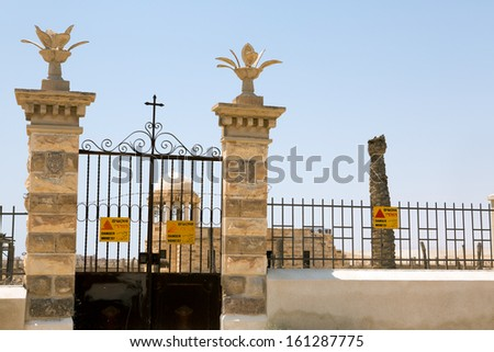 Danger Mines sign on a fence in Israel at Qasr el Yahud site - stock photo