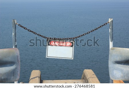 Danger no swimming sign in sea - stock photo