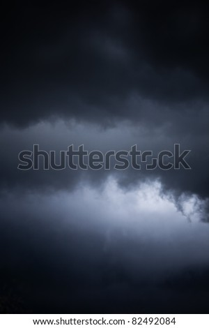 danger of an impending storm, a dark stormy sky - stock photo