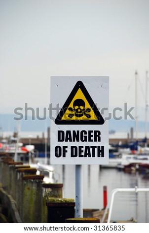 Danger of death sign at a marina - stock photo