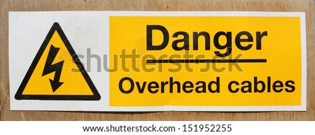 Danger Overhead wires warning sign - stock photo