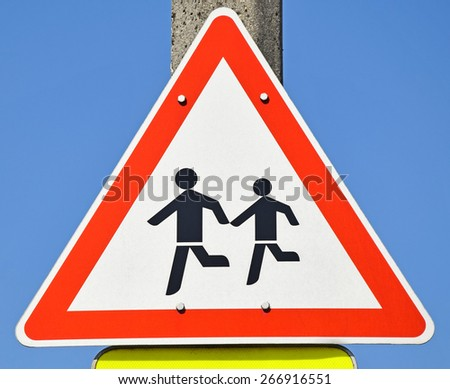 Danger, pedestrians on the road traffic sign - stock photo