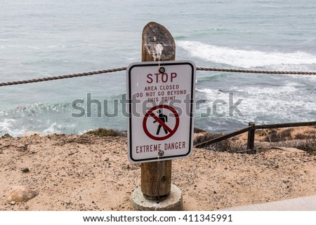 Danger sign at the Point Loma tidepools in San Diego, California.   - stock photo