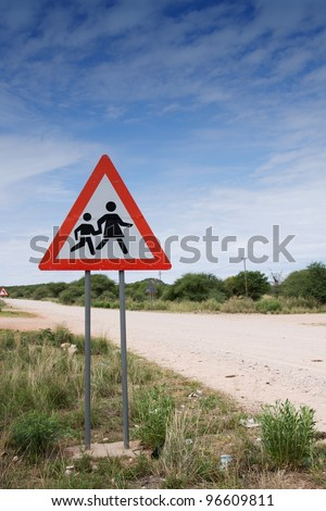 Danger sign: children crossing road, Namibia - stock photo