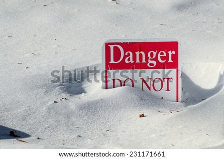 Danger Sign Covered in Snow - stock photo