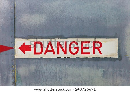 Danger sign on an old jet fighter airplane - stock photo