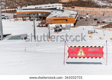 Danger signs on winter skiing resort - stock photo