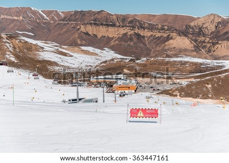 Danger signs on winter skiing resort - stock photo