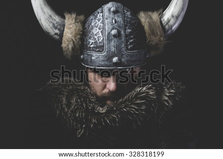 Danger, Viking warrior with iron sword and helmet with horns - stock photo