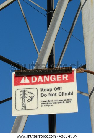 danger voltage sign on electrical tower