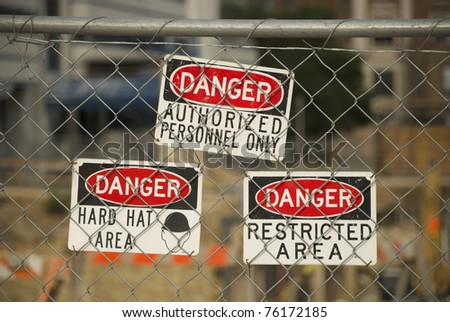 Danger/warning signs at a construction site. - stock photo