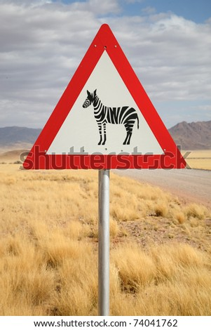 Danger Zebra Crossing Road Sign close to Country Road, Namibia, South West Africa - stock photo