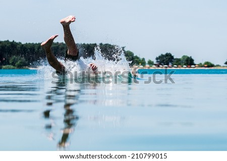 Dangerous accident in water, jung man drowning. - stock photo