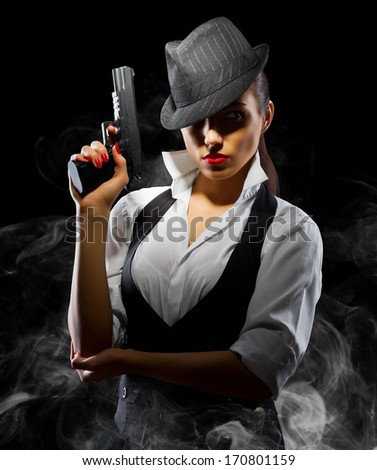 Dangerous and beautiful criminal girl with gun on smoky background - stock photo