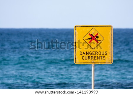 Dangerous currents sign on Bronte beach, Sydney, New South Wales, Australia - stock photo