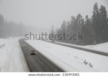 Dangerous driving on snow-covered interstate highway in winter - stock photo