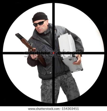 Dangerous gangster or terrorist in a police sniper's scope. Security and insurance concept. - stock photo