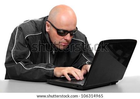 Dangerous hacker with laptop. Data security concept. - stock photo