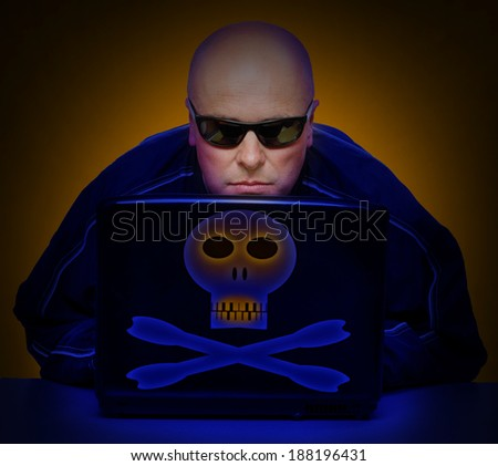Dangerous hacker with laptop. Online security concept. - stock photo