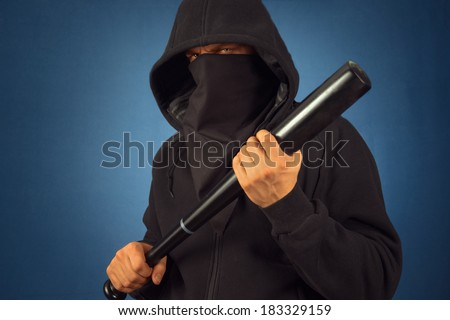 Dangerous man in the mask with baseball bat ready for fight - stock photo