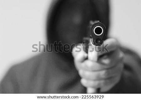Dangerous man with a gun - stock photo