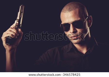Dangerous man with a gun - stock photo