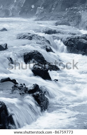 dangerous rocks in the river in winter