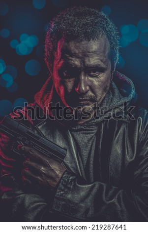 dangerous secret agent with gun and police emergency lights - stock photo