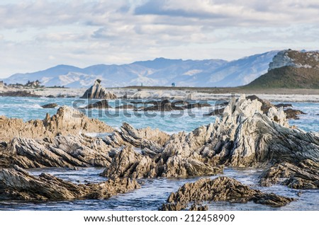 dangerous sharp rocks in the sea - stock photo