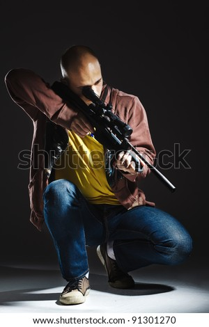 dangerous sniper with the rifle - stock photo