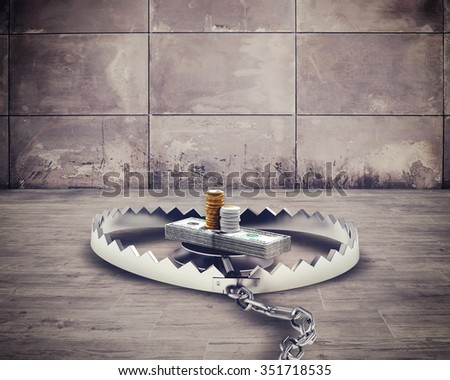 Dangerous steel mouse trap with bait money - stock photo